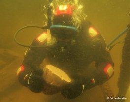 Underwater, excavating the crannog.